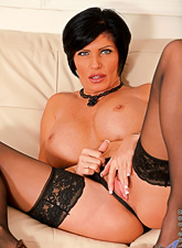Big breasted classy brunette MILF takes her lingerie off and toys her wet muff
