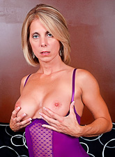 Classy blonde vixen takes her sexy purple lingerie off and shows her big jugs