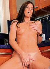 Smoking hot busty brunette MILF takes her dress off and fingers her hungry wet vagina