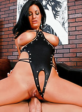 Seductive busty brunette MILF babe takes her black lingerie and rides a huge dong