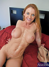 Big breasted redhead babe takes her clothes off and fucks with well endowed hunk.