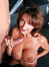 Big breasted mature mom gets down on her knees and sucks a big hard meat pole.