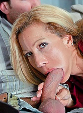 Foxy mature wife takes her red lingerie off and slurps on large hard boner.
