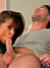 Hot busty brunette MILF takes her green dress and wanks a hard throbbing meat pole.
