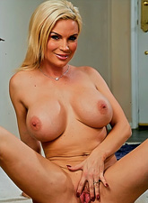 Smoking hot busty blonde gets down on her knees and blows a hard throbbing shaft.