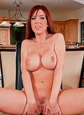Foxy redhead housewife takes her blue dress off and gets rammed by big shaft.