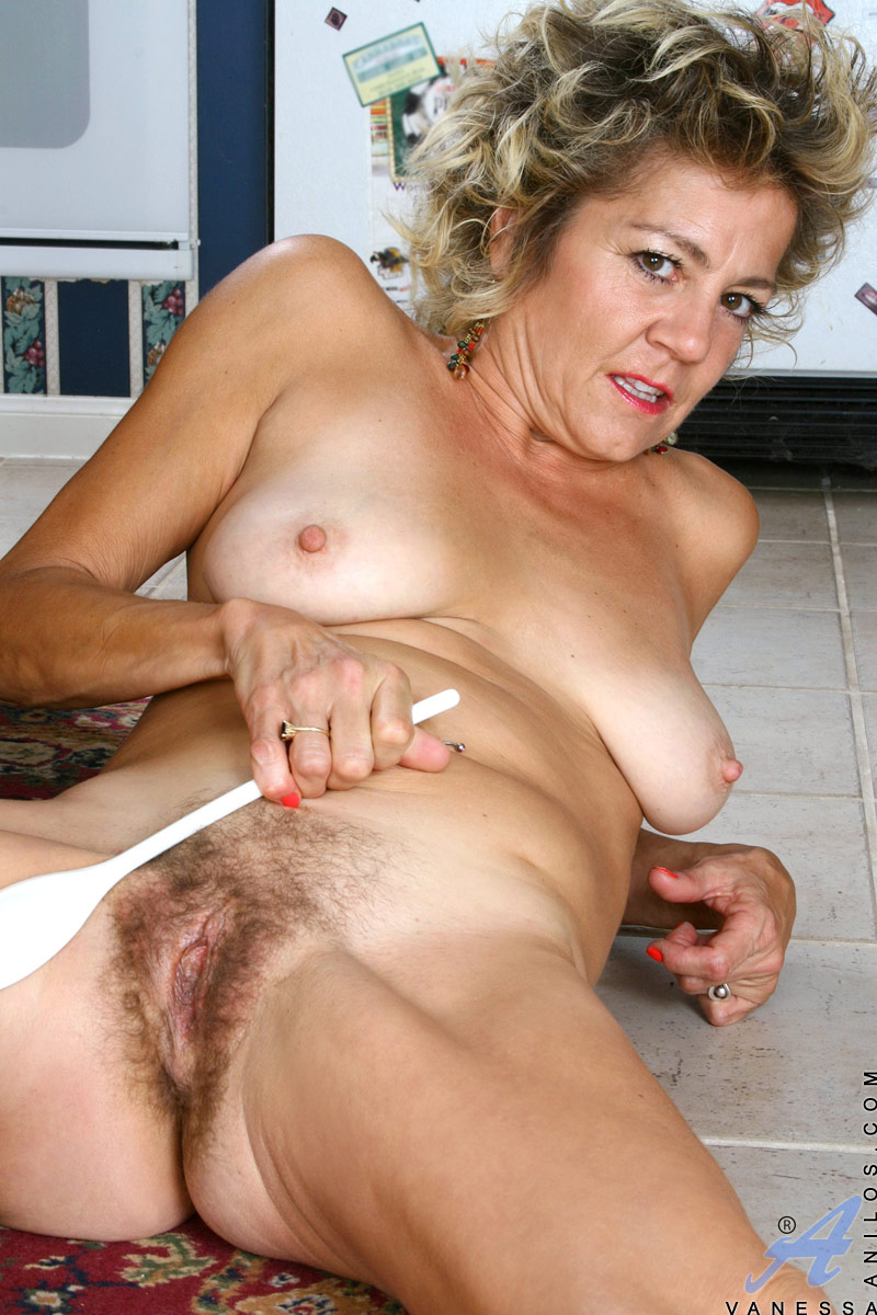 Horny mature opening hairy pussy