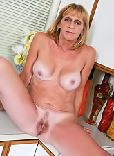 Horny housewife in sexy white stockings stripping and teasing with her body