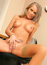 Sexy mature babe with a tight tanned body and hot tits fingering her shaved pussy
