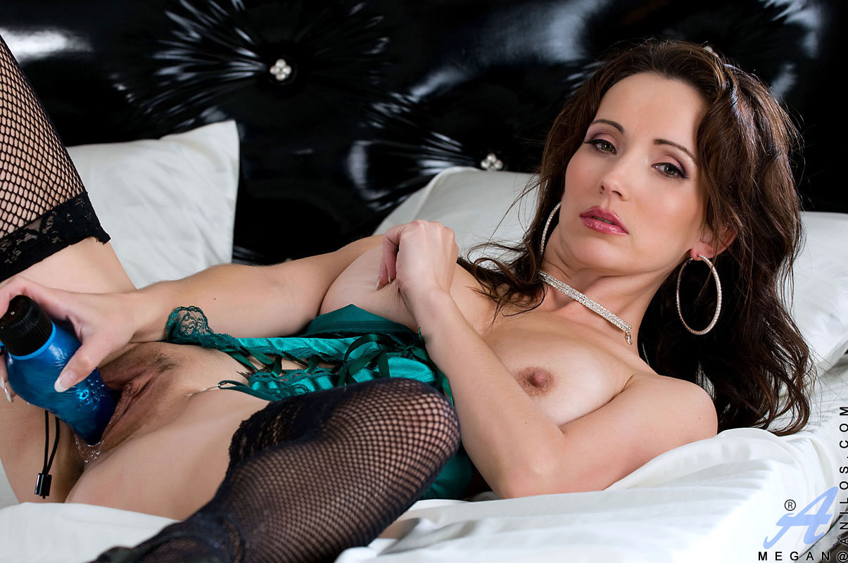 ... Sexy slim mature brunette with nice tits and a hairy pussy poses in a  hot corset ...