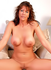 Sexy tanned milf with a hot curvy body and massive boobs posing and teasing