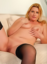 Sexy mature blue eyed babe in hot black stockings with saggy boobs and shaved pussy