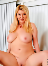 Sexy busty milf with a round soft body and big saggy boobs fingering her pussy