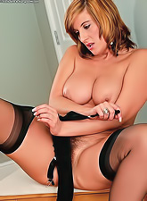 Hot milf with a gorgeous curvy body, thick thighs and natural saggy boobs fingering