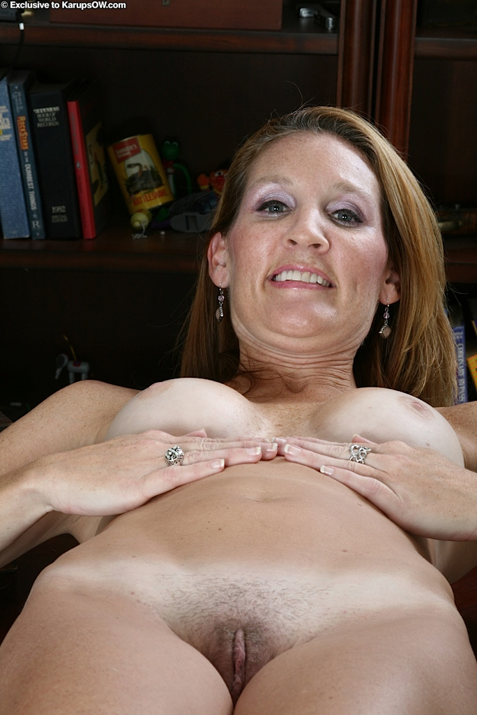 Sexy milf stripping and fingering