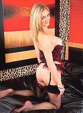 Beautiful and cute blond babe gets rid of her red lingerie and shows her tits n pussy