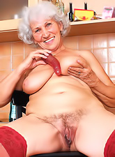Cute and sexy granny gets off her dress and undies and shows her tits and pussy