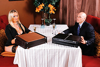 Abbey Brooks takes her slutty black dress off and then fucks with her handsome bald business partner