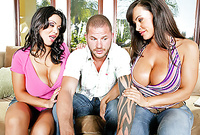 Lisa Ann and Sienna West strip their slutty outfits on the sofa and then suck their mutual lover's big cock