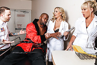 Julia Ann takes all of her clothes before the camera and then shares a big black cock with another slut