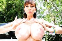 Alia Janine takes all of her clothes before the camera and shows us her massive round jugs outdoors