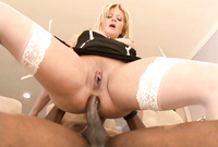 Ginger Lynn spreads her sexy legs in white stockings and gets her asshole madly drilled by huge boner