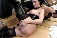 Carmen Rivera takes her little panties off and fingers her muff in slutty black heel boots