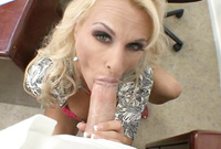 Holly Halston goes down on her knees and treats her handsome lover with a blowjob