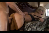 Amber Lynn wears classy black lingerie off and gets her muff nailed by big hard cock