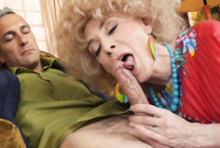 Nina Hartley removes all of her clothes in front of the camera and blows her lover's big throbbing cock