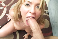 Alice Bell goes down on her knees before her handsome lover and passionately sucks his throbbing hard cock