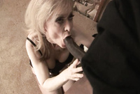 Nina Hartley takes her sexy, classy black lingerie in front of the camera and swallows her lover's throbbing black dong