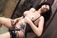 Seductive brunette shemale bitch takes her clothes off and wildly wanks her throbbing meat rod