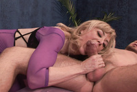 Nina Hartley strips her sexy purple lingerie in front of the camera and strokes off a big throbbing piece of meat