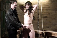 Skinny brunette hoe gets tied up in the dungeon and then brutally banged by kinky old dude
