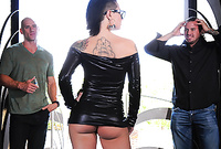 Christy Mack takes her slutty black leather dress and gets her tight pussy drilled by two big hard dongs