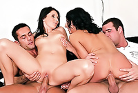 Eva Torres and her good looking brunette lover strip together and get their pussies baned by two horny guys