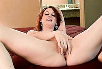 Audrey Lords spreads her sexy legs in front of the camera and fingers her shaved hungry deep meat hole in front of the camera