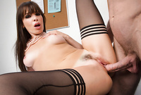 Dana DeArmond spreads her sexy legs in black stockings and gets her tight bush drilled by throbbing hard schlong before the camera