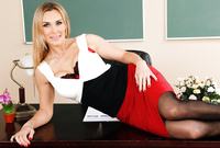 Tanya Tate takes her sexy red skirt off on the desk and teases us with her amazing piece of hot booty