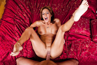 Tara Holiday shows us her amazing big jugs and jerks off a throbbing hard schlong before the camera