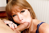 Darla Crane kneels before her handsome lover and treats him with an amazing killer blowjob for the camera